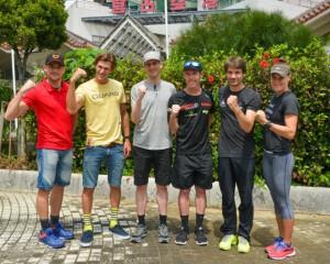 宮古島に来島した海外招待選手。(左から)アロシュン選手、コリンズ選手、ワイリーマン選手、ブラウン選手、ヤン選手とオズボーン選手=19日、宮古空港