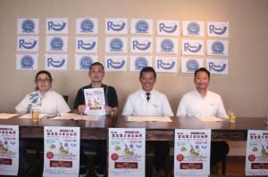 うまむぬ杯の開催を発表する奥平会長(右から2人目)ら=28日、市内飲食店